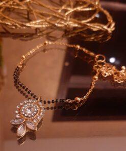 Black beads rakhi with dazzling kundan